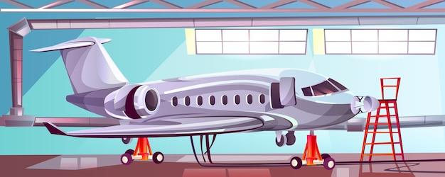 Zilveren vliegtuig in mechanische garage