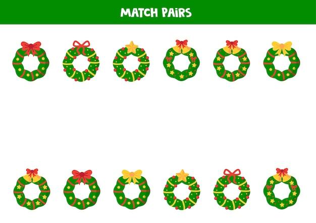 Zoek een paar voor elke kerstkrans. educatief logisch spel. werkblad voor kinderen.