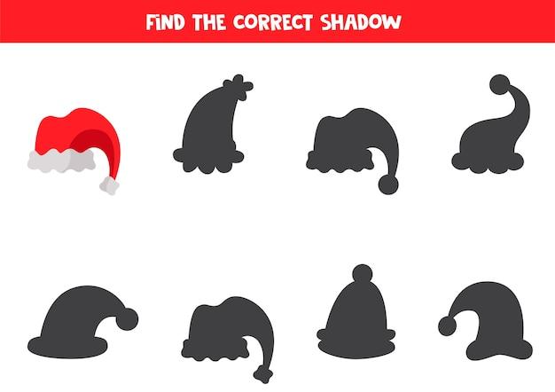 Zoek schaduw van cartoon kerstmuts logisch educatief spel voor kinderen