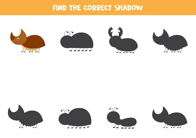 Zoek schaduw van schattige neushoornkever. educatief logisch spel voor kinderen. Premium Vector