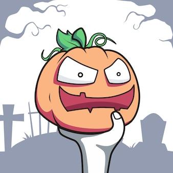 Zombiehand houdt de pompoen met glimlachgezicht vast