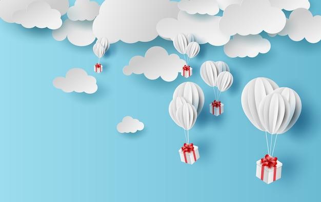 Zomertijd ballonnen geschenkdoos zweven.