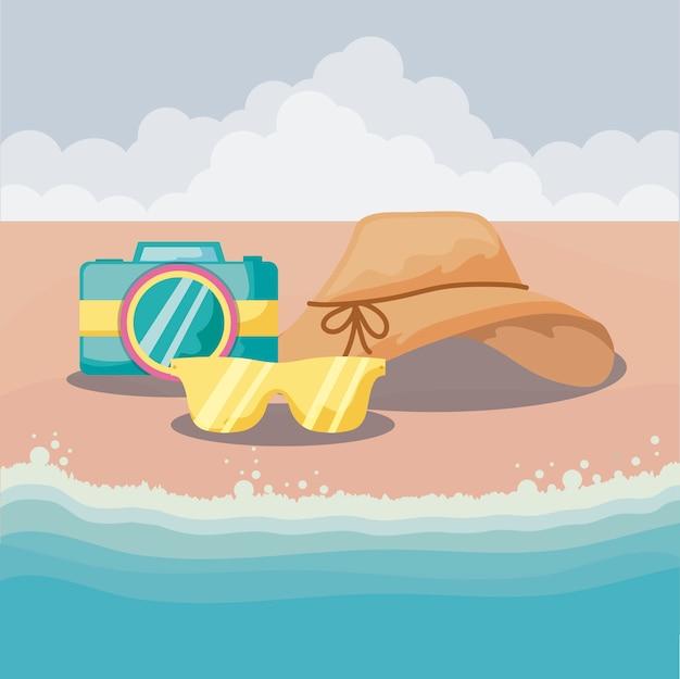 Zomervakantie met camera en accessoires in strand
