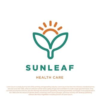 Zon en twee bladeren symboolpictogram gezondheidszorg logo voor ziekenhuiskliniek en apotheek