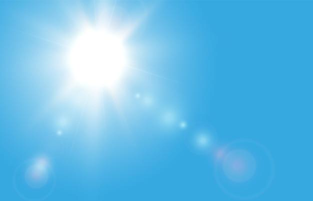 Zon op een blauwe hemelachtergrond met stralen en highlights