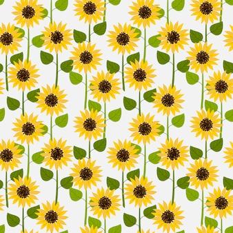 Zonnebloemen op wit bleek naadloos patroon als achtergrond.