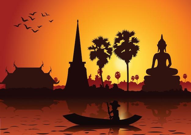Zonsondergang landschap en boeddha thaise tempel en roeiboot