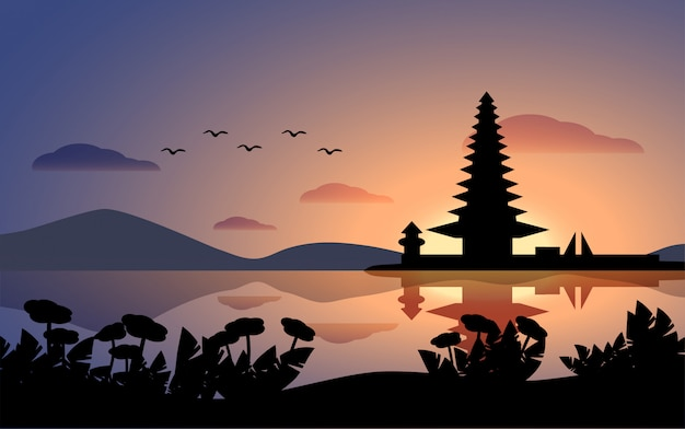 Zonsonderganglandschap van bali met tempel en meer