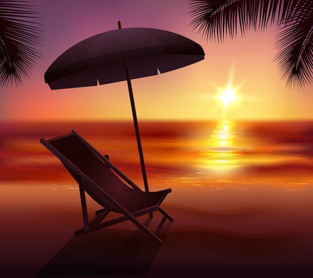 Zonsonderganglounge en paraplu op strand