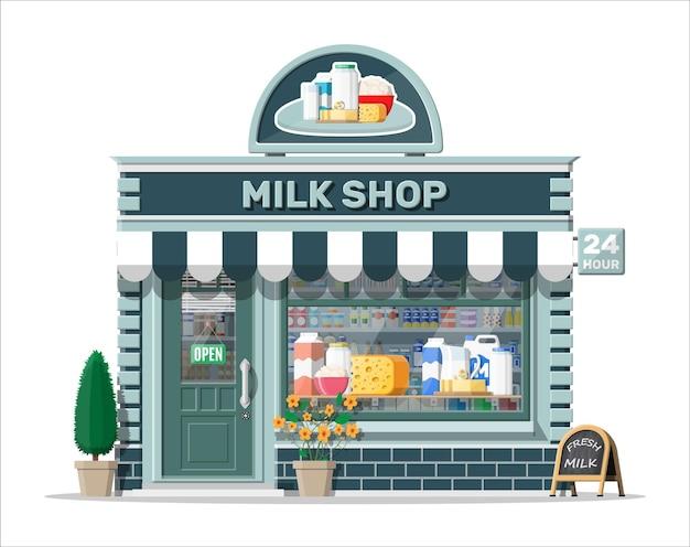 Zuivelwinkel of melkwinkel met uithangbord, luifel. winkelgevel met winkelpui. boerenwinkel