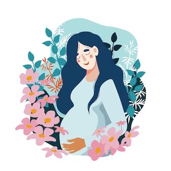 Zwangere vrouw omringd door vele bloemen.