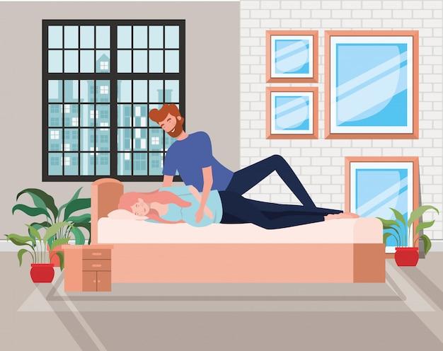 Zwangerschapspaar in slaapkamer kenmerkt