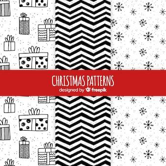 Zwart en wit hand getrokken kerst patroon collectie