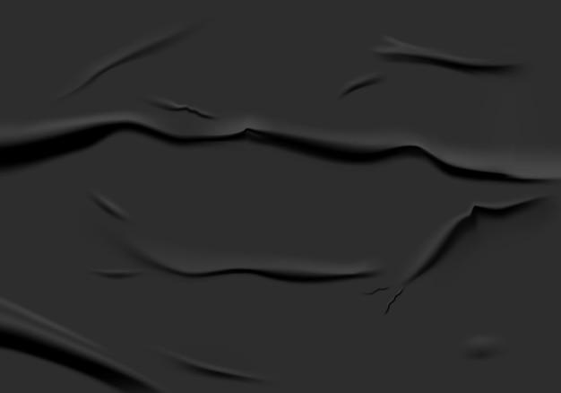 Zwart gelijmd papier met nat gerimpeld effect. zwart nat papier poster sjabloon met verfrommeld textuur. realistische posters