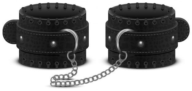 Zwart lederen handboeien aan ketting. accessoire speelgoed voor fetish bdsm-spel