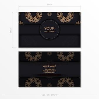 Zwart luxe visitekaartjeontwerp met gouden vintage ornament.