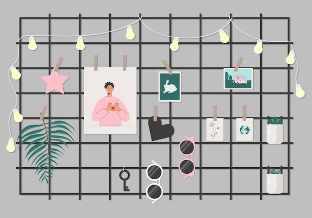 Zwart raster memobord met foto's en verschillende kunstdecor