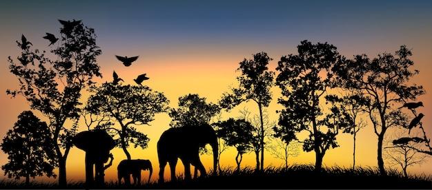 Zwart silhouet van bomen en dieren.