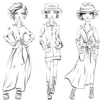 Zwart-wit set van schattige mooie meisjes in jas, jas en rok, hoed en laarzen
