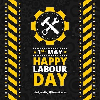 Zwarte achtergrond met gele en witte elementen voor dag van de arbeid