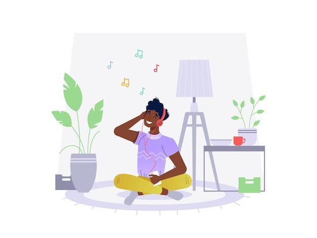 Zwarte afro-amerikaanse man luisteren muziek thuis zittend op de vloer vector platte cartoon