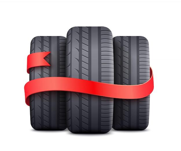 Zwarte autobanden omwikkeld met rood lint - gratis geschenk of korting promotie-element