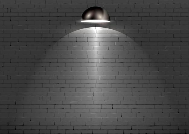Zwarte bakstenen muur en lamp