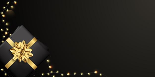 Zwarte banner met geschenkdozen en lichten.