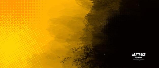 Zwarte en gele abstracte achtergrond met grungetextuur