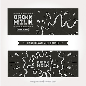 Zwarte en witte banners met spatten van melk
