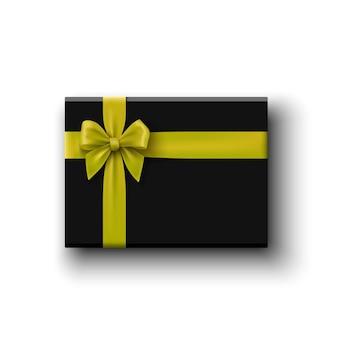 Zwarte geschenkdoos met gele strik op wit, bovenaanzicht
