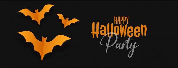 Zwarte halloween banner met gele origami vleermuizen