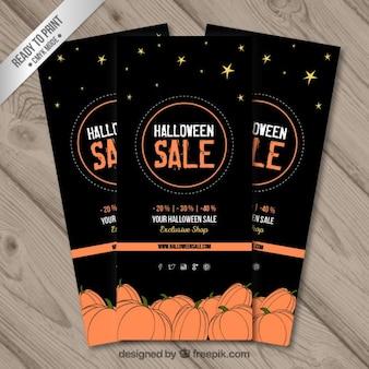 Zwarte halloween verkoop banners met schetsmatige pompoenen