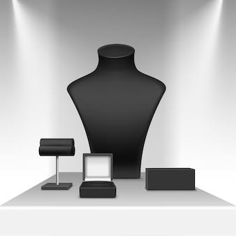 Zwarte ketting oorbellen en armband staan voor sieraden met doos