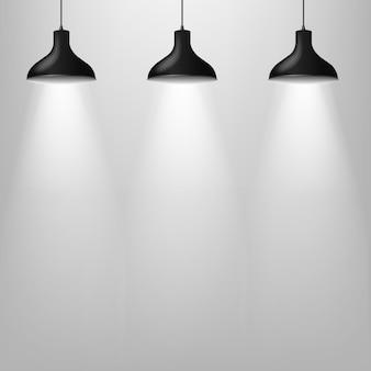 Zwarte lamp met grijze muur