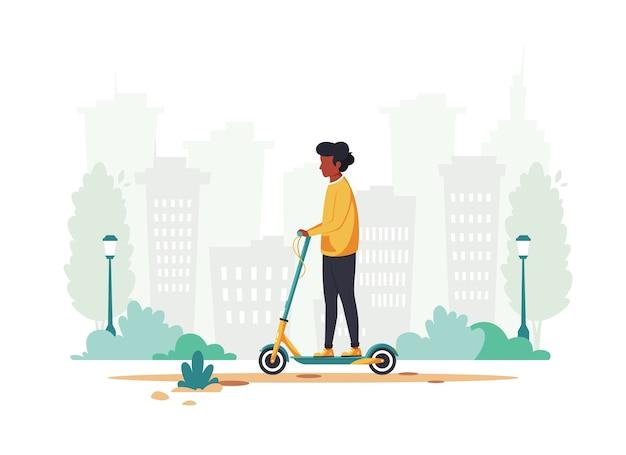 Zwarte man elektrische scooter rijden in de stad