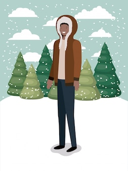 Zwarte man in snowscape met winterkleren