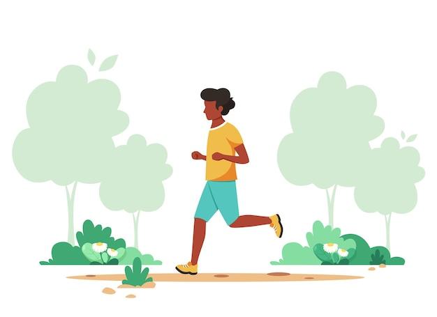 Zwarte man joggen in voorjaar park