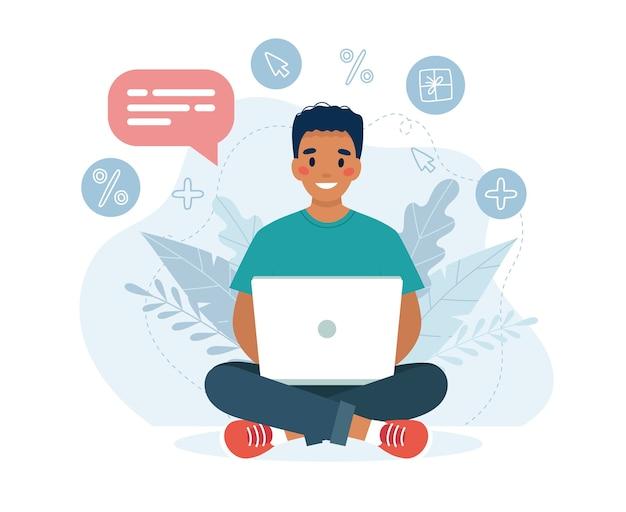 Zwarte man met een laptop werk-, student- of extern werkconcept