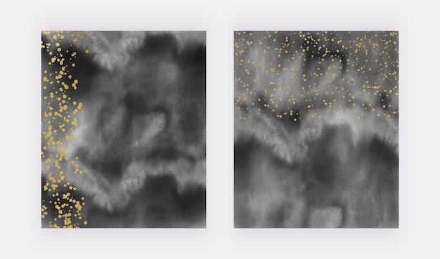 Zwarte penseelstreek aquarel achtergronden met gouden confetti