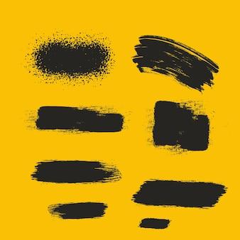 Zwarte penselen verf de texturen ontwerp graffiti-streken gele uitstrijkborstels