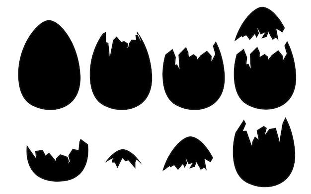 Zwarte silhouetten van eierschalen hele en gebarsten of gebroken schelpen platte vectorillustratie geïsoleerd op een witte achtergrond