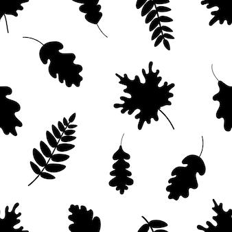 Zwarte silhouetten van verschillende bladeren die een naadloos patroon vormen op een witte achtergrond