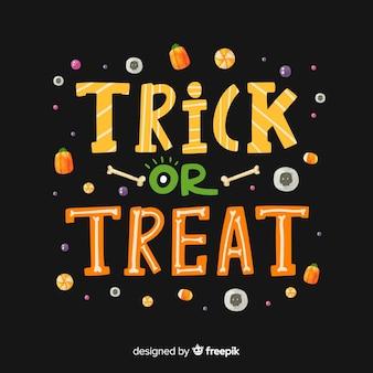 Zwarte trick or treat-belettering met snoepjes