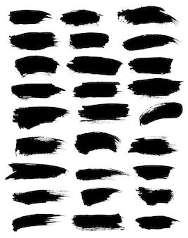 Zwarte verfvlekken en aquarel- of markeringspenseelstreken markeerstift Premium Vector