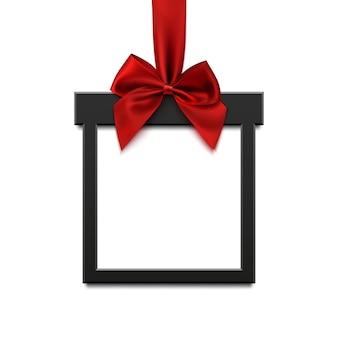 Zwarte vierkante banner in de vorm van kerstcadeau met rood lint en boog