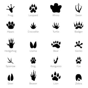 Zwarte voetafdrukken van dieren. olifant, luipaard, reptiel en tijger.