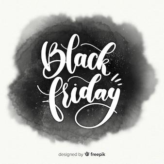 Zwarte vrijdag verkoop achtergrond met aquarel vlekken
