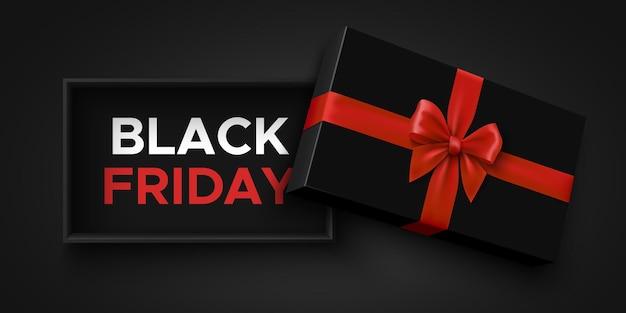Zwarte vrijdag verkoop banner met open geschenkdoos en rode strik