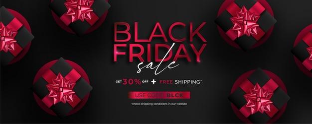 Zwarte vrijdag verkoop banner met realistische cadeautjes